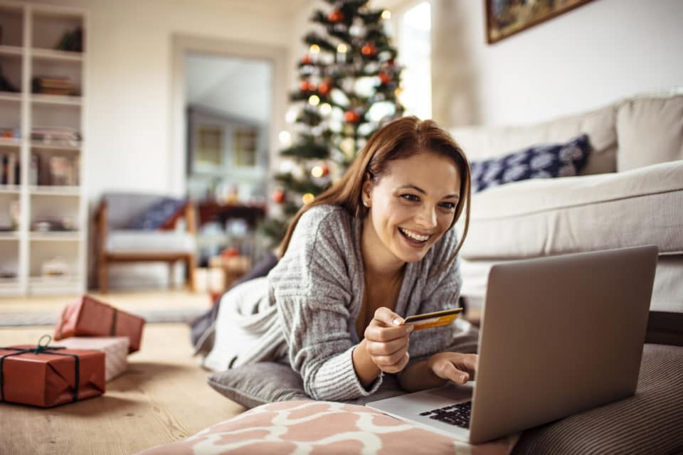 Close up of a young woman buying presents online