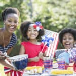 Family celebrating a patriotic holiday and enjoying a meal outdoors