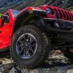 Shot of the wheels and under carriage of a Jeep Wrangler parked on some rocks