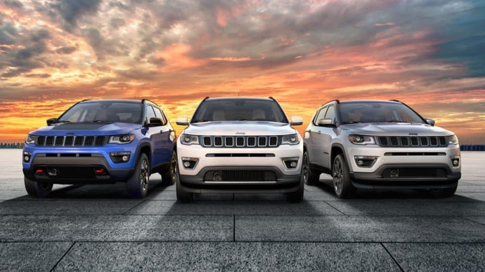 A front-end view of three 2020 Jeep Compass SUVs side by side