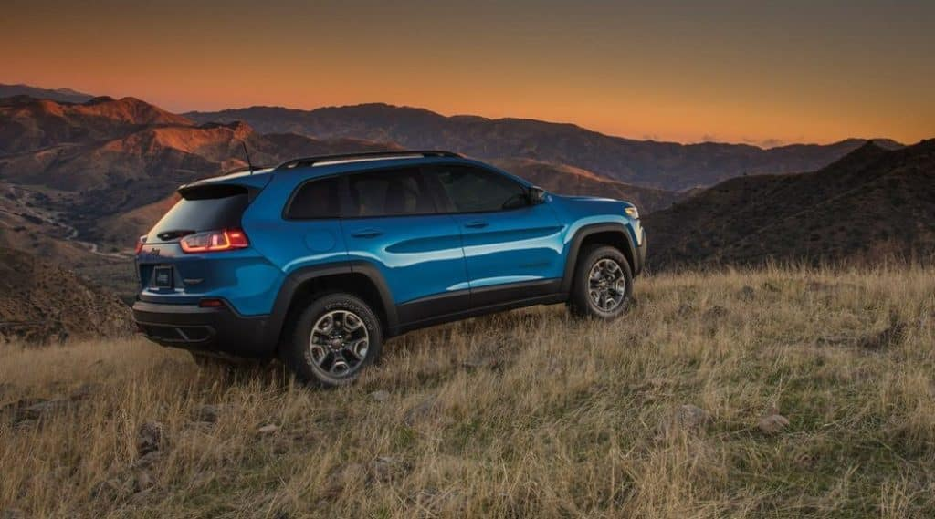 Cherokee on hill at sunset