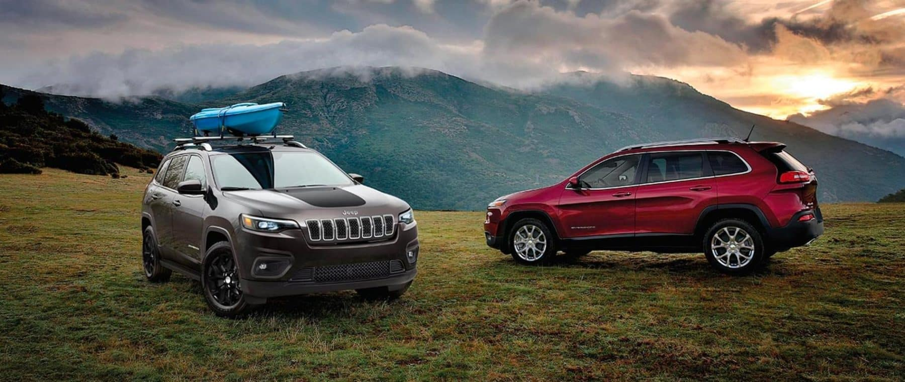 Two Jeep Cherokee's on a mountain top.