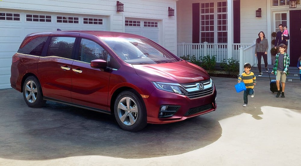 2018 Honda Odyssey with Family in driveway