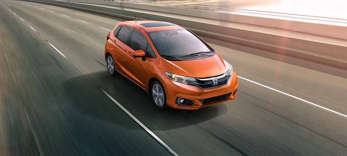 2018 Orange Honda Fit on Highway