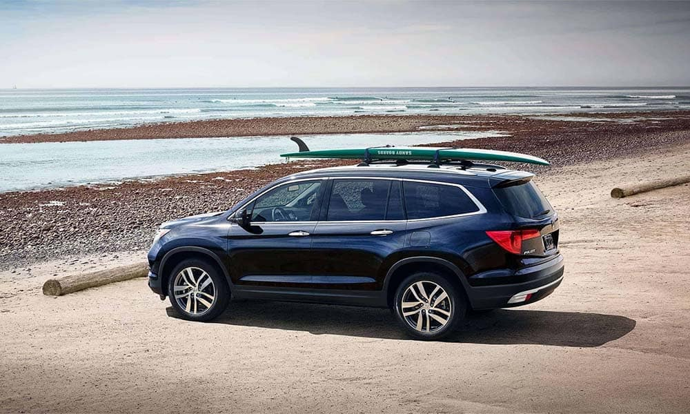 2018 Honda Pilot at the beach with surfboard
