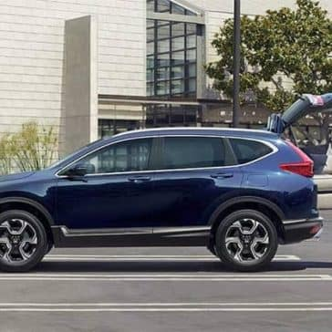 Couple loading their blue Honda CR-V