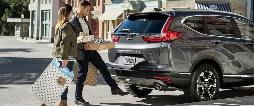 Couple Loading Presents into 2019 Honda CR V Cargo Area