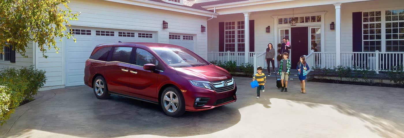 Family walking out of house to Honda Odyssey