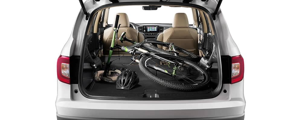 Bike and equipment stored in cargo area of honda pilot
