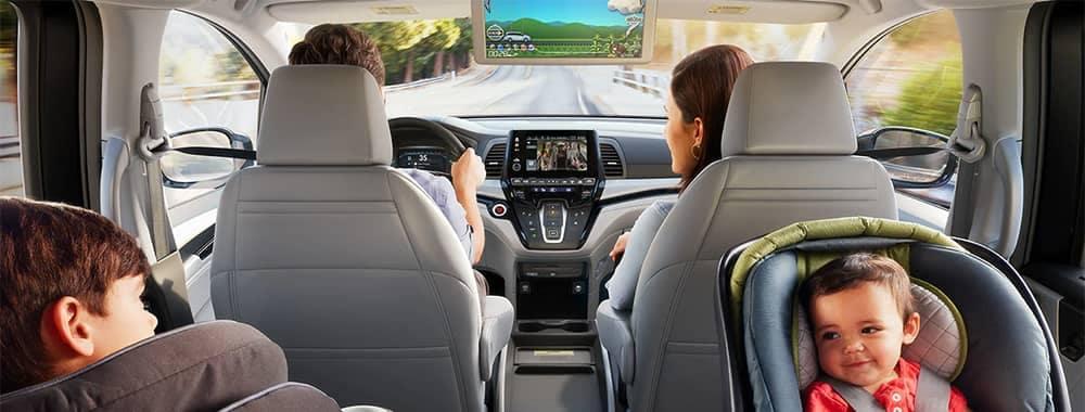 Family driving in Honda Odyssey