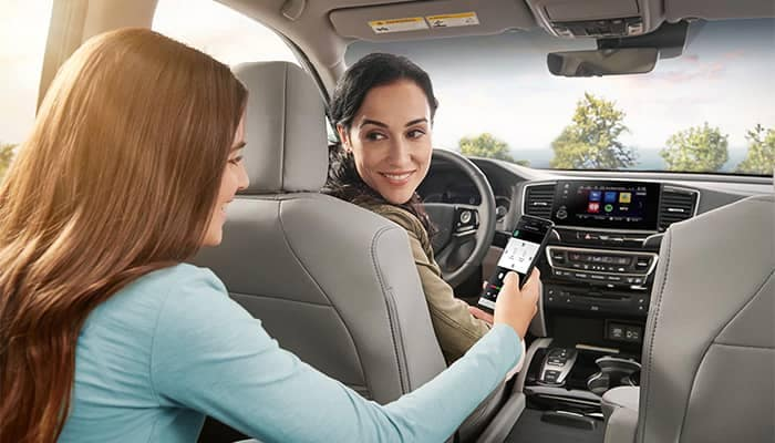 Mother and daugher driving in Honda Pilot
