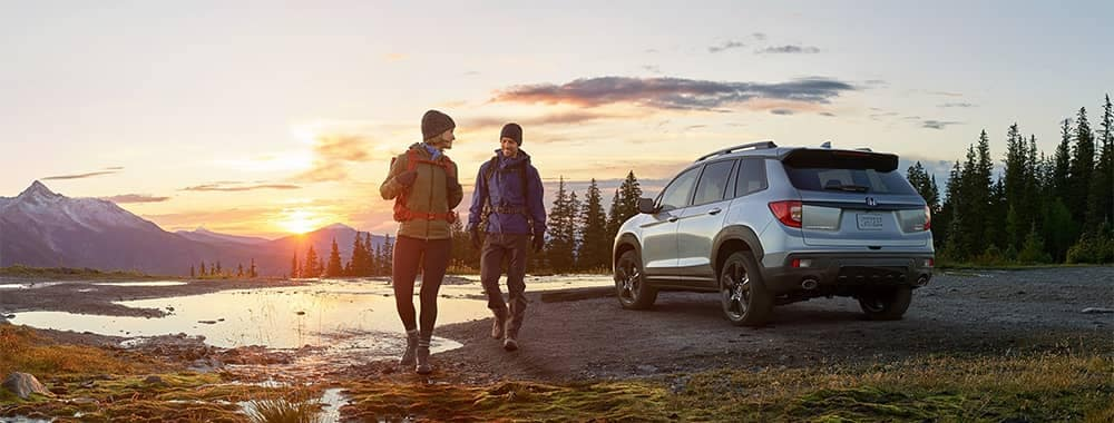 Couple hiking with Honda Passport