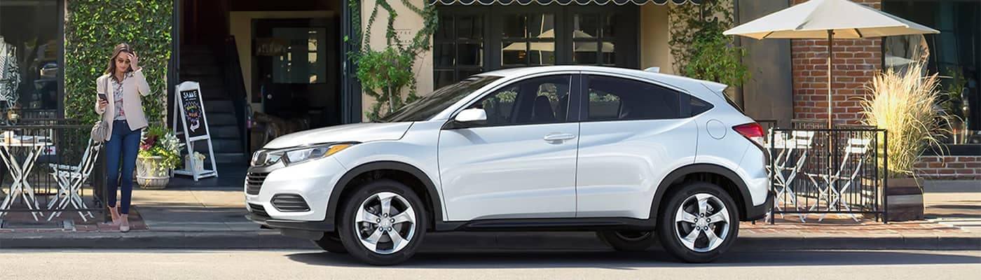 Honda CR-V Parked Curbside in Front of Store