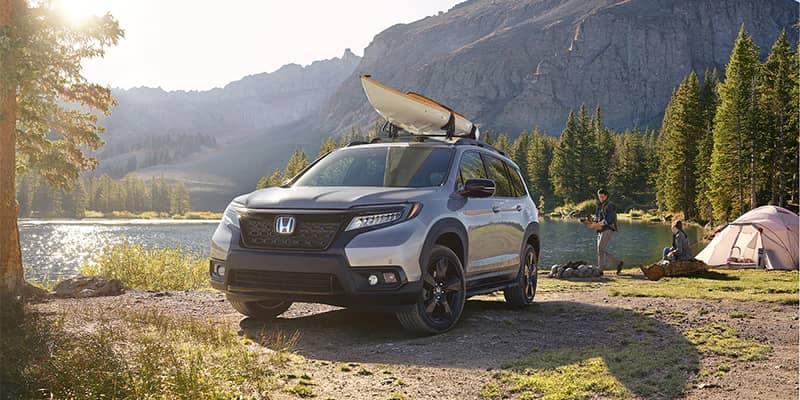 Honda Passport Parked by Lake Camping