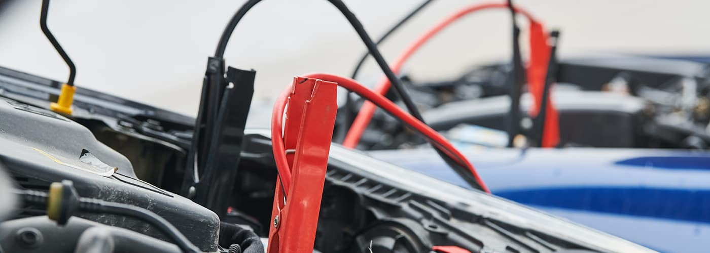 Jumper cables hooked up to 2 cars