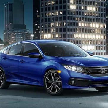 2019 Honda Civic Sedan Parked with City in the Background