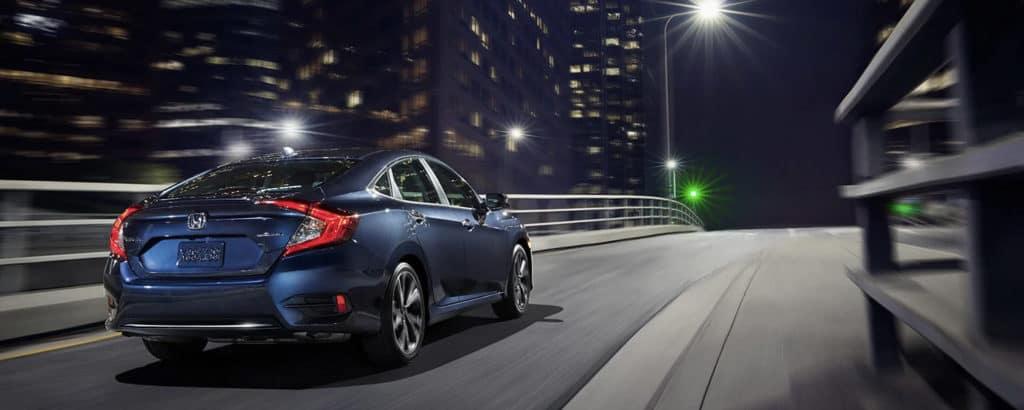 2020 Honda Civic driving fast in city at night