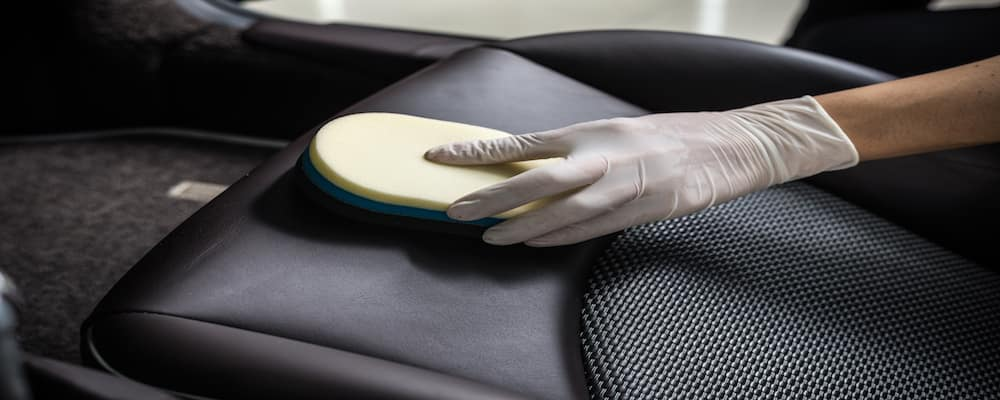 hand cleaning luxury leather car seats