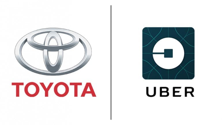 Toyota partners with Uber for autonomous vehicle research.