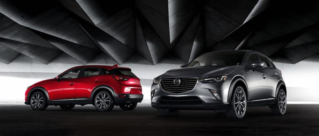 red and silver 2018 Mazda CX-3 on gradient background