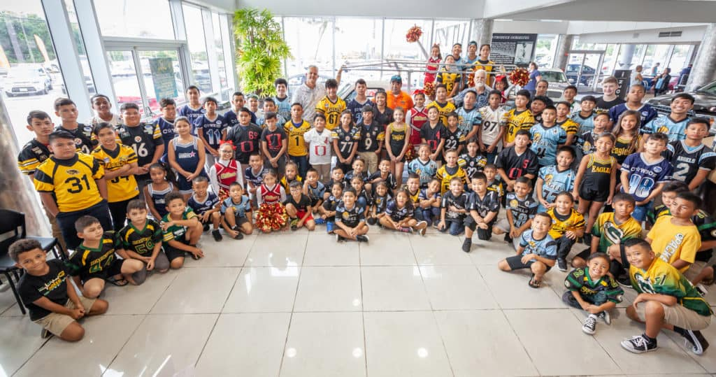 Guam National Youth Football Federation league members at Triple J Auto
