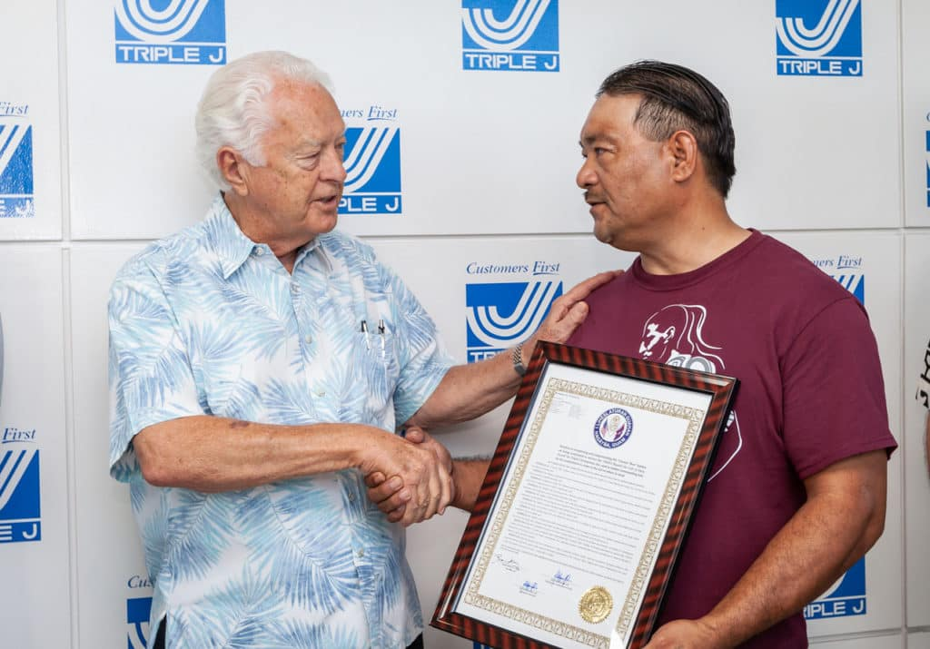 Ben Sablan receives certificate of recognition at Triple J Auto