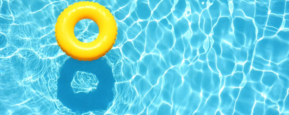 Yellow Water Tube floating in blue pool