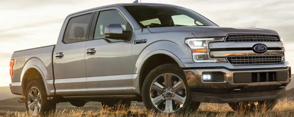 Silver 2019 Ford F-150 profile at sunset