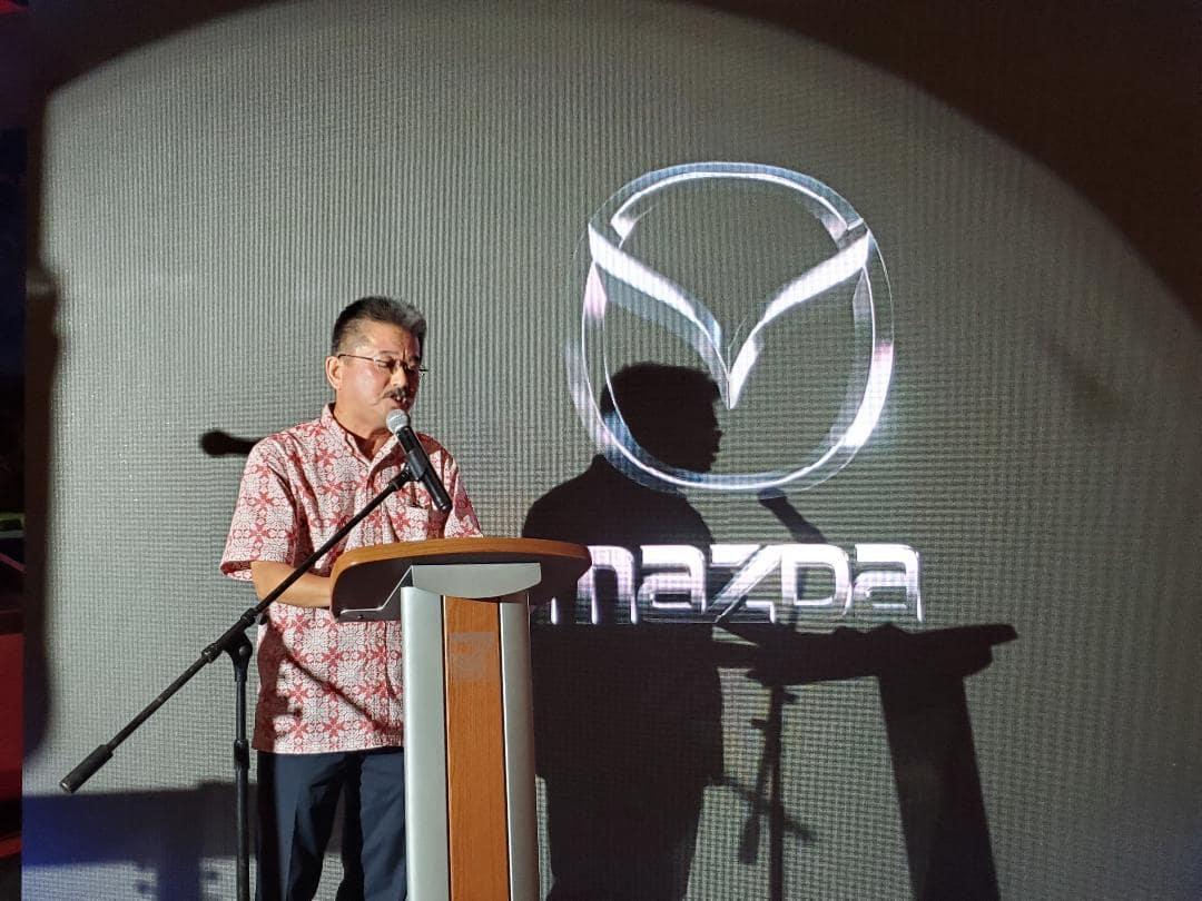 Mr. Yoshida speaking at release event for 2020 Mazda3 at Triple J Auto Guam