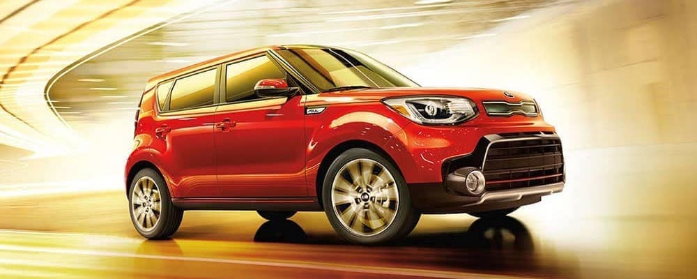Red 2019 Kia Soul in well lit stylized tunnel