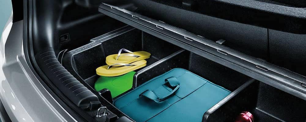 Close on rear cargo space in Kia Soul with sandals and other beach gear
