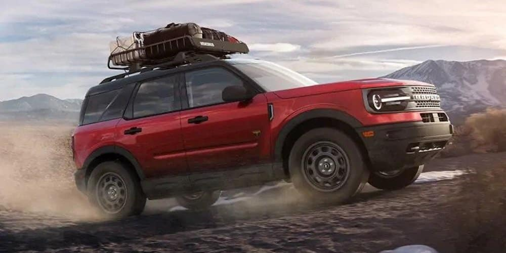 Red 2021 Ford Bronco Driving on Dirt