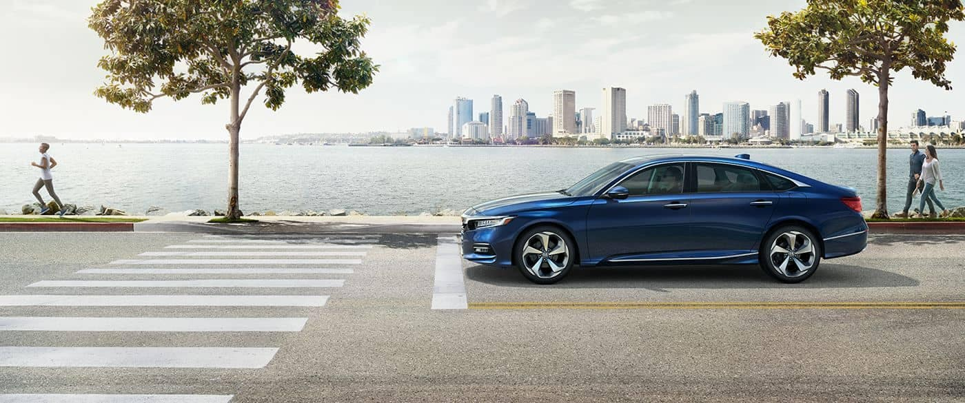 2018 Honda Accord Sedan stopped on street with city in the background
