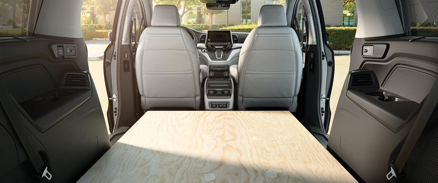 Rear seats folded down to put in wooden slab inside 2020 Honda Odyssey cargo space