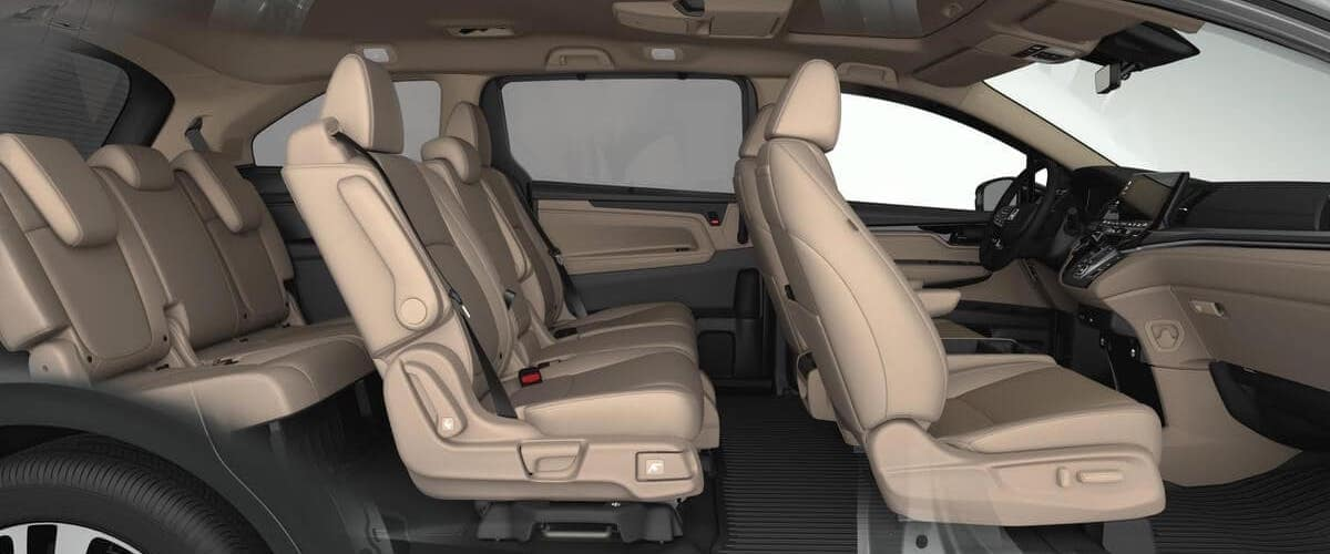 Side view of 2020 Honda Odyssey interior with tan seats