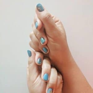 hands showcasing nail polish
