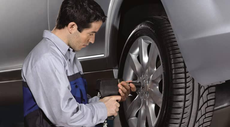 MB Technician Installing Tire