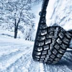 Car tires on snowy road