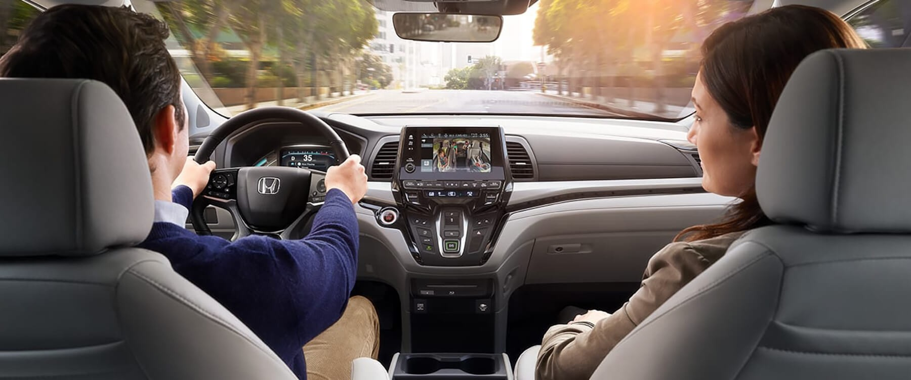 Driver and Passenger in 2018 Honda Odyssey