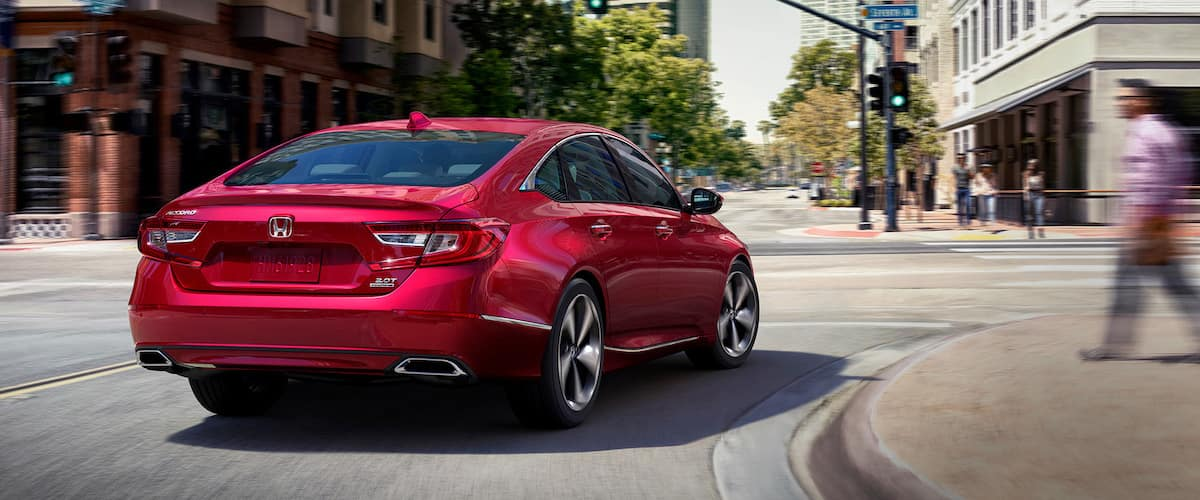 Red 2020 Honda Accord with adaptive damper system rounding a corner