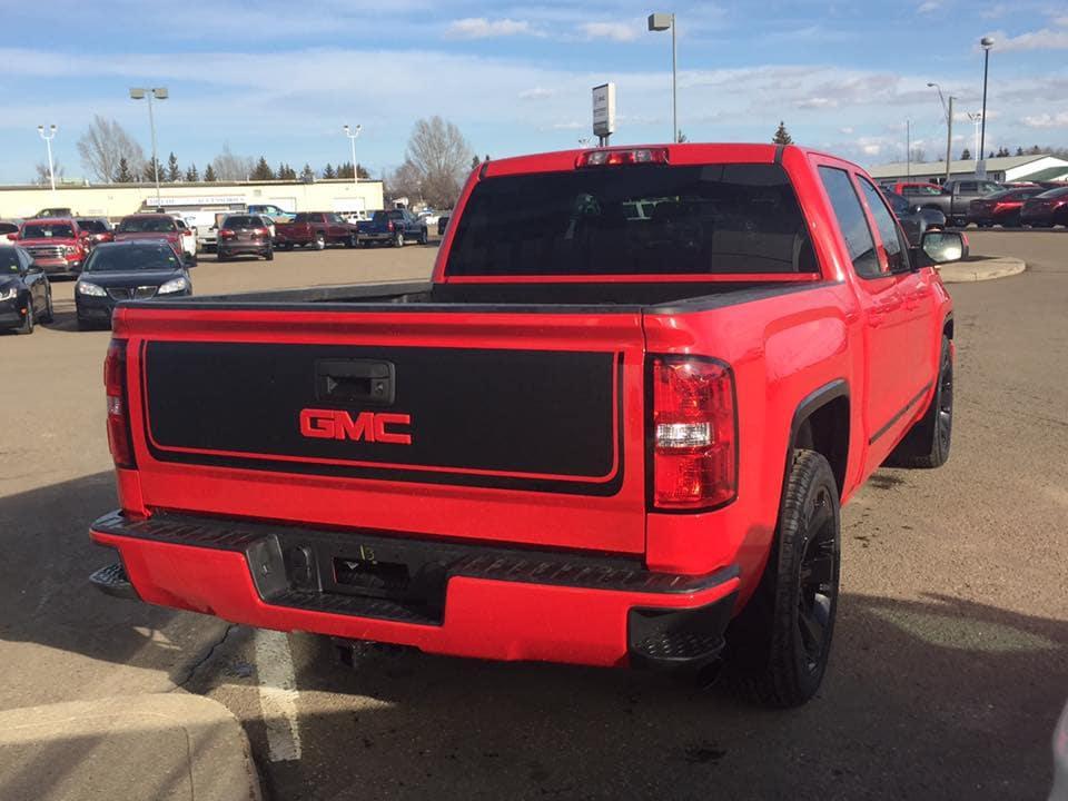 Black on red Custom GMC Sierra Pickup Truck - Westridge Customs