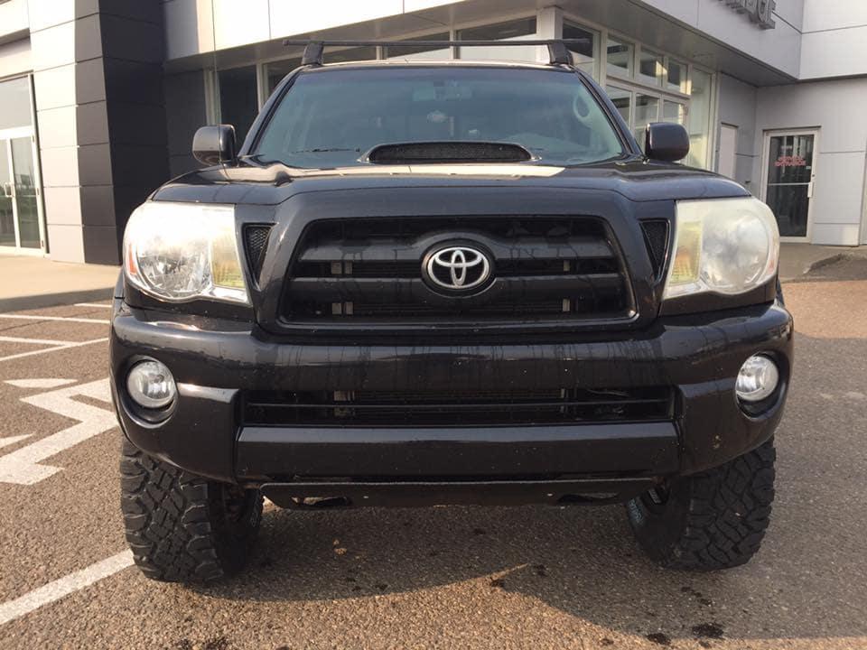 Customized Black Toyota Tacoma Pickup Truck - Westridge Customs