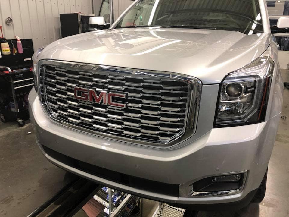 Customized Silver GMC Sierra Pickup Truck - Westridge Customs