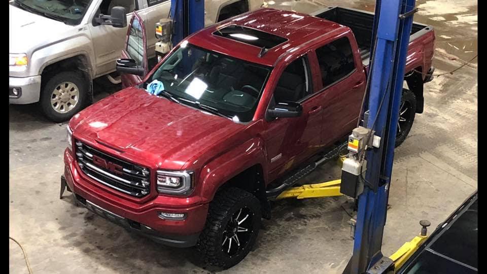 Customized Red GMC Sierra Pickup Truck - Custom Rims - Westridge Customs