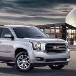 2016 GMC Yukon XL front view in front of modern building