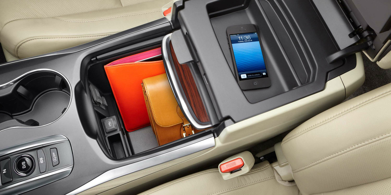 2016 MDX multiple storage compartments in center console