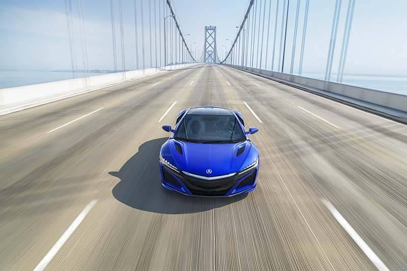 Acura NSX driving over a bridge
