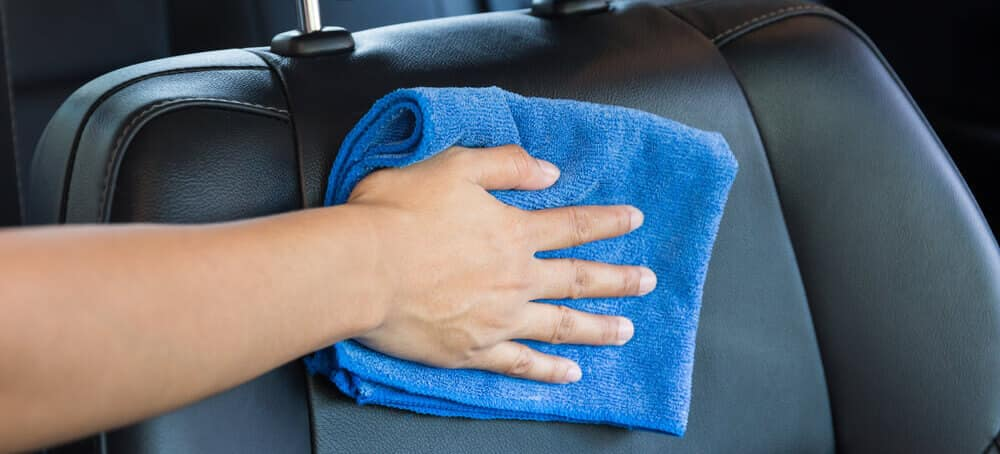 Clean leather with microfiber towel