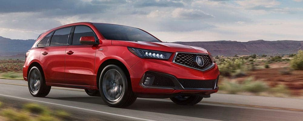 2019-Acura-MDX-Red-Driving-Down-Road
