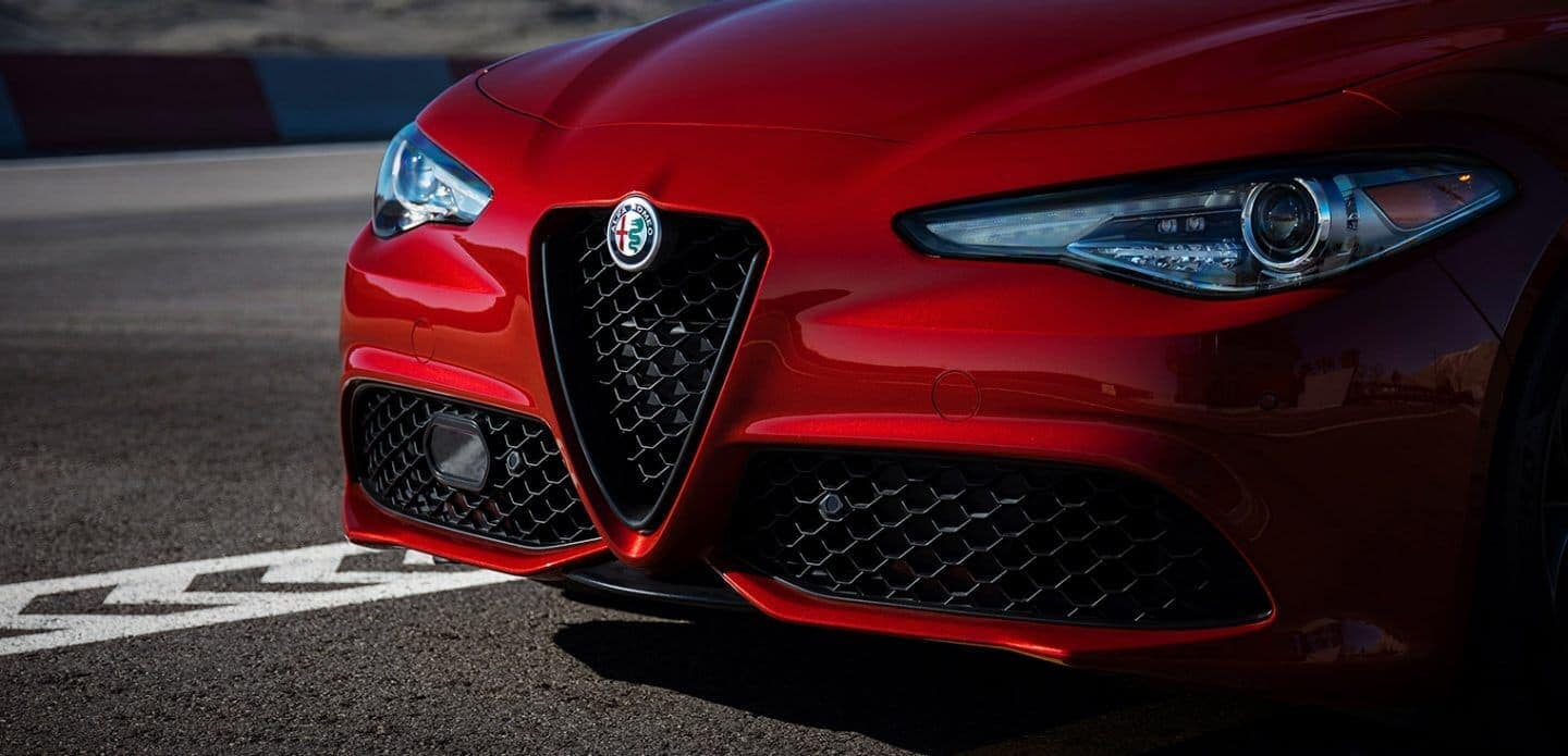 2019 Alfa Romeo Giulia in red driving on race track